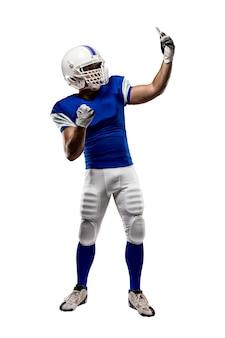Fußballspieler mit einer blauen uniform, die ein selfie auf einer weißen wand macht