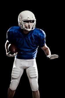 Fußballspieler mit nummer auf einer blauen uniform und einem ball in der hand.