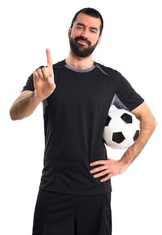 Fußballspieler zählt eins
