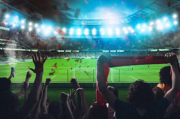 Fußballszene bei nacht mit jubelnden fans im stadion