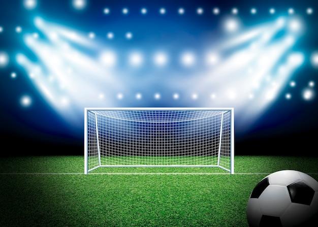 Fußballtor und -fußball mit scheinwerferhintergrund im stadion