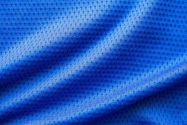 Fußballtrikot der blauen farbe stoffsportkleidung mit hintergrund der luftmaschenbeschaffenheit