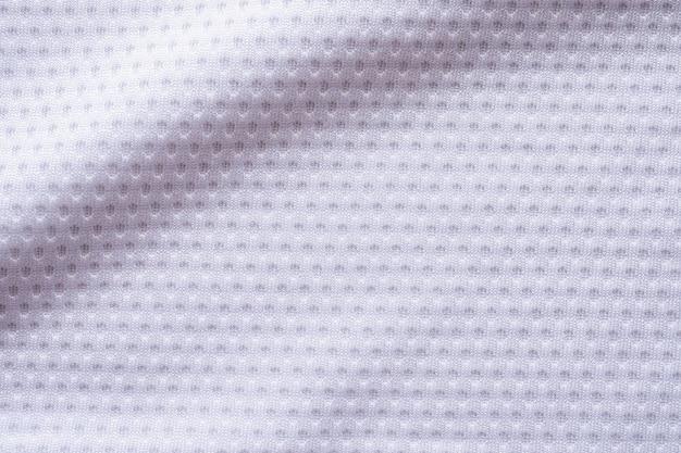 Fußballtrikot der weißen stoffsportkleidung mit hintergrund der luftmaschenbeschaffenheit
