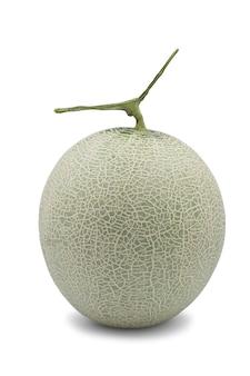 Ganze organische honigtau-melone auf weißem hintergrund