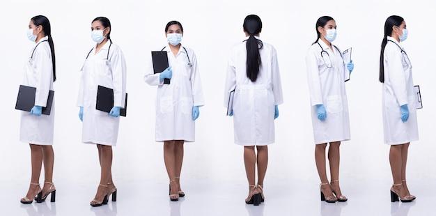 Ganzkörperlänge figur snap der 20er jahre asiatische frau trägt arzt weiße uniformhose, rock und schuhe, weißer hintergrund isoliert