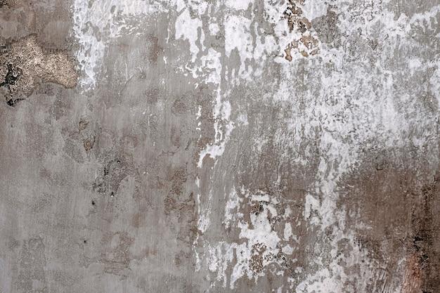 Gealterte graue betonwandbeschaffenheitsnahaufnahme