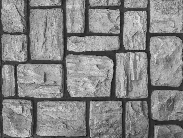 Gealterter verwitterter stein, der gehenden weisenoberflächenhintergrund pflastert.