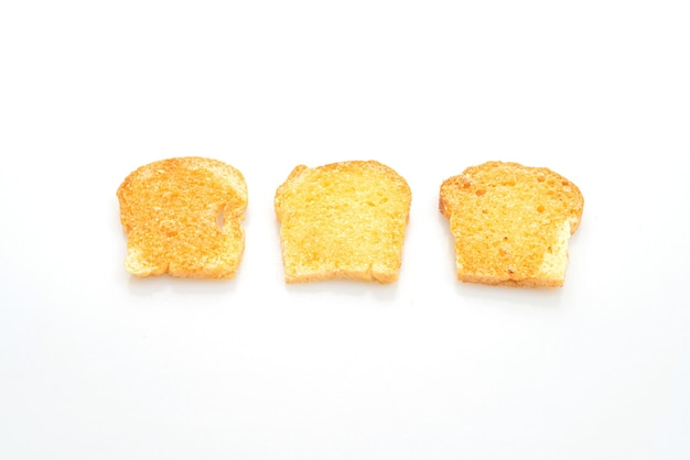 Gebackenes knuspriges brot mit butter und zucker isoliert auf weißem hintergrund
