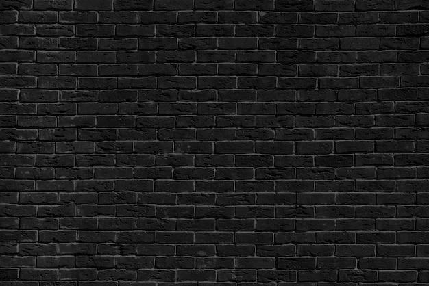 Gebäudewand aus schwarzem backstein. innenraum eines modernen lofts. hintergrund für die gestaltung