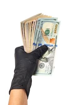 Geben sie medizinische handschuhe mit einer packung dollar ab. das konzept der infektion für geld, schmutziges geld
