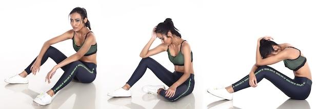 Gebräunte haut asiatische frau trägt fitness-sport-bh-yoga-hosen-turnschuhe. weibliche bewegung in voller länge und schweiß gesund über weißem hintergrund isoliert, konzept nie aufgeben