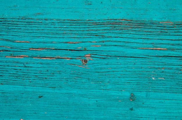 Gebrochene verwitterte blaue und grüne shabby chic gemalte holzbrettbeschaffenheit, vorderansicht