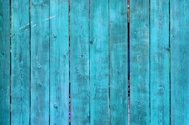 Gebrochene verwitterte grüne und blaue gemalte beschaffenheit des hölzernen brettes
