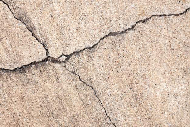 Gebrochene zementbeschaffenheit auf boden- oder wandhintergrund.