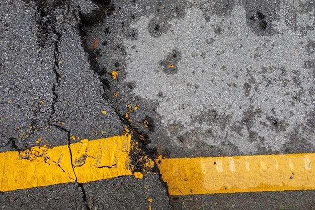 Gebrochener asphalt und textur