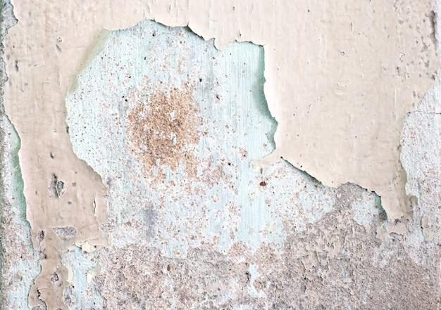 Gebrochener zerfall malte betonmauerbeschaffenheitshintergrund, schmutzwand