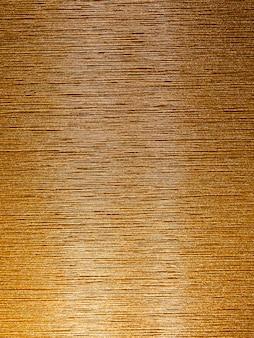 Gebürsteter goldhintergrund