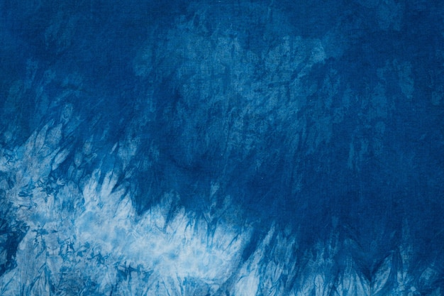 Gefärbte indigo stoff hintergrund und strukturiert