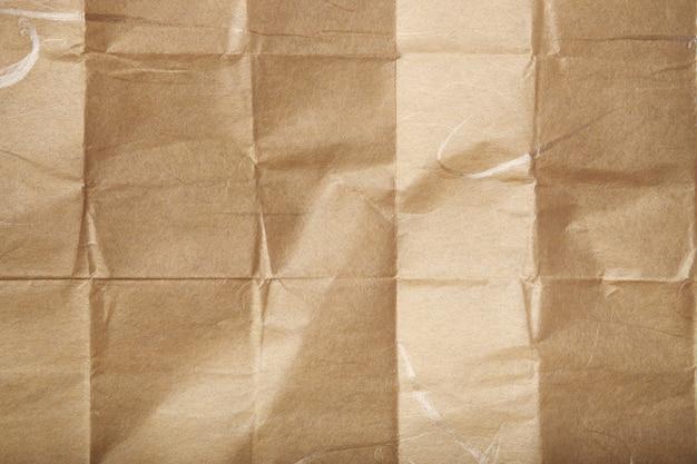 Gefaltete beige papierstruktur