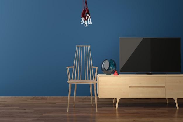 Geführter fernsehapparat auf holzfußboden der blauen wand
