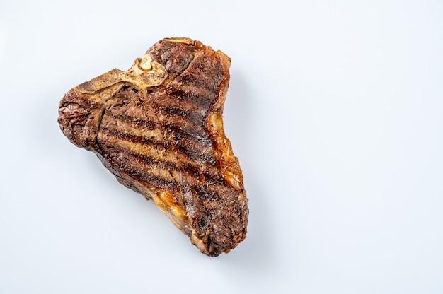 Gegrilltes t-bone-steak flach lag isoliert weißen hintergrund
