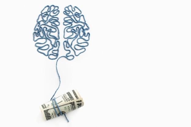 Gehirn und geld durch einen faden verbunden