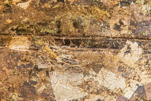 Geknitterter goldener strukturierter hintergrund