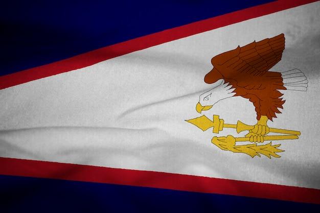 Gekräuselte flagge von amerikanisch-samoa, die im wind durchbrennt