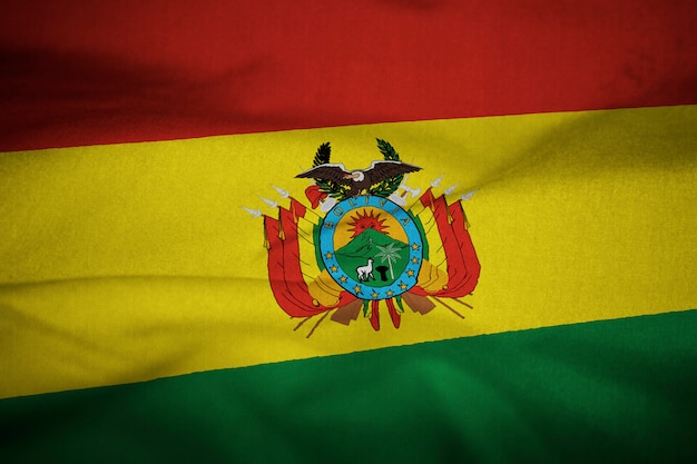 Gekräuselte flagge von bolivien im wind wehen