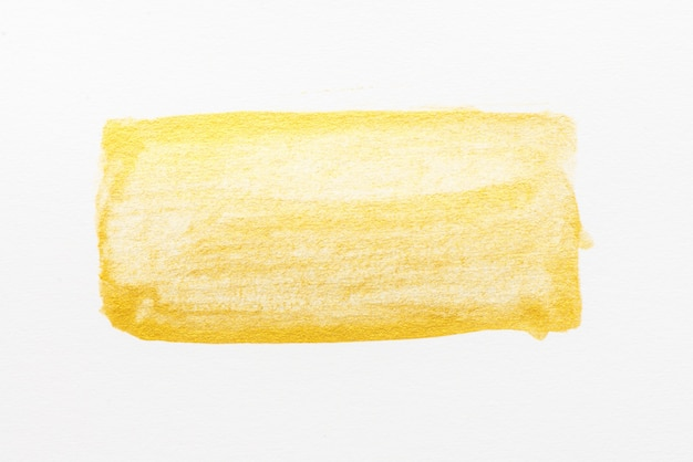 Gelbe abstrakte aquarellmalerei gemasert auf weißbuchhintergrund
