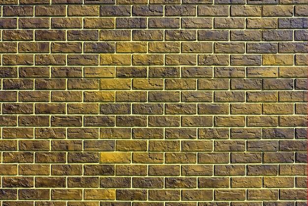 Gelbe backsteinmauer. moderne baubranche. fassade des gebäudes.