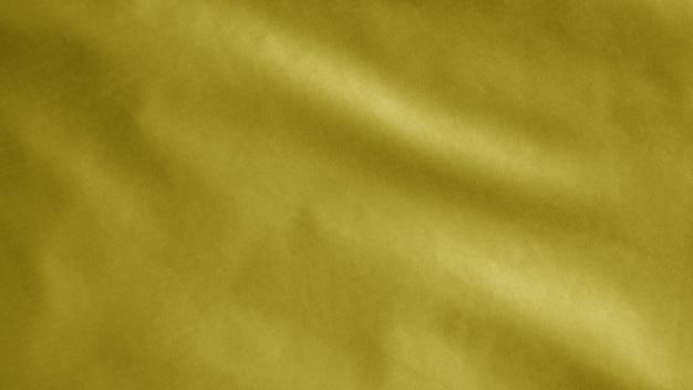 Gelbe flagge weht mit wind. internationales maritimes signalbanner weht, weiche und glatte seide. stoff textur fähnrich hintergrund