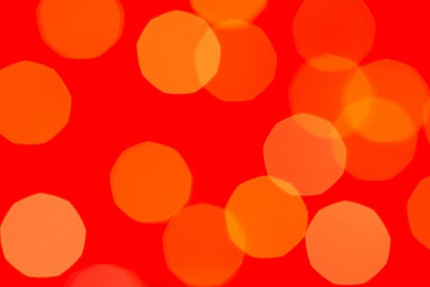 Gelbe funkeln boke beschaffenheit auf rot
