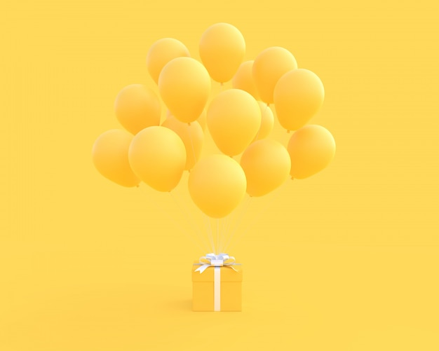 Gelbe geschenkbox mit ballon auf gelbem hintergrund