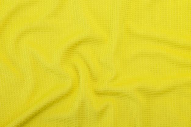 Gelbe gewebebeschaffenheit, stoffmusterhintergrund