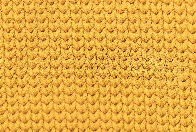 Gelbe senffarbe gestrickte weiche texturwand