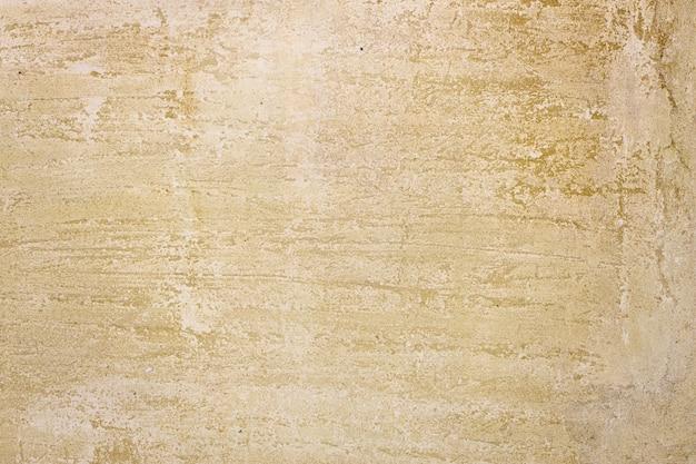 Gelbe steinmauer. strukturierte oberfläche. grunge-hintergrund. foto in hoher qualität