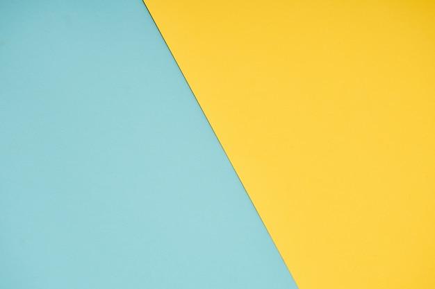 Gelbe und blaue pastellpapierfarbe für hintergrund