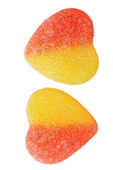 Gelbe und rosa marmelade in herzform bonbons in zucker