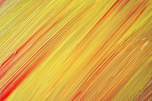 Gelbe und rote farben des abstrakten kunsthintergrundes. aquarellmalerei mit goldenen strichen. acryl