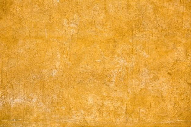 Gelbe verputzte gebäudewand des gebäudes