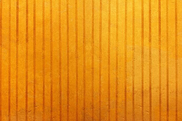Gelber alter schmutziger betonmauerbeschaffenheitshintergrund