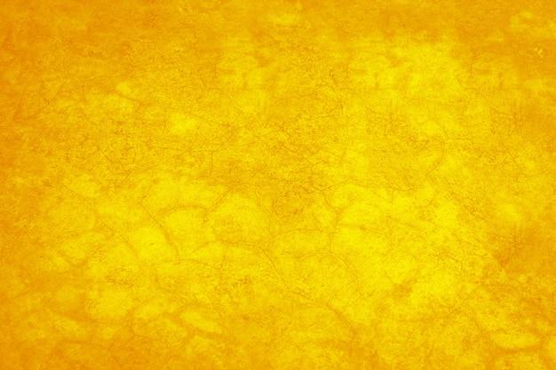 Gelber beton oder zementmaterial in abstrakter wandbeschaffenheit.