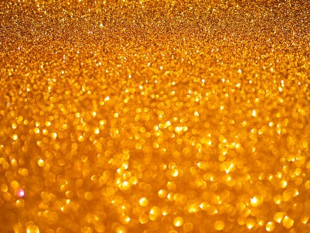Gelber glitzernder tapetenhintergrund