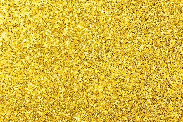 Gelber glitzertexturhintergrund, sandpapper hochdetaillierte oberfläche, leuchtendes glüheffektkonzeptfoto