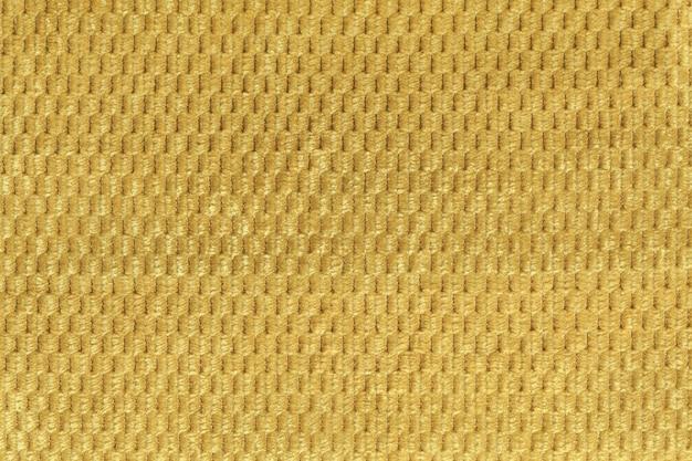 Gelber hintergrund vom weichen flauschigen gewebeabschluß oben. textur von textilien makro