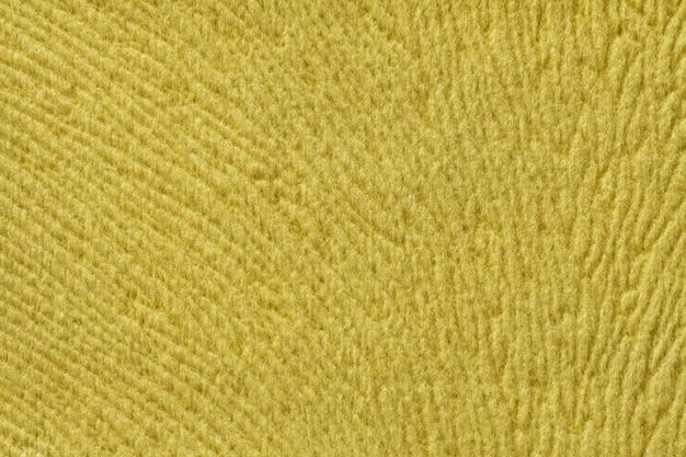 Gelber hintergrund vom weichen textilmaterial. stoff mit natürlicher textur.