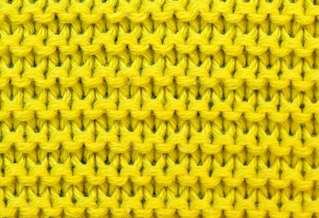Gelber hintergrund von gestrickt