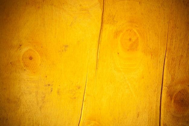 Gelber holzbretthintergrund.