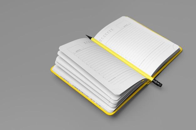 Gelber notizblock mit gelbem stift auf grauem hintergrund
